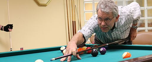 Senior Citizen shooting pool