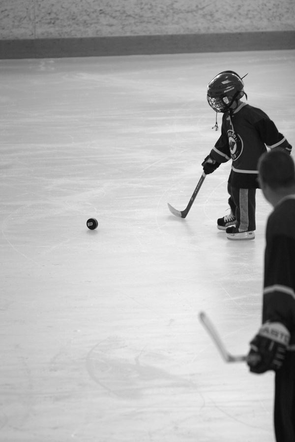 Hockey Child Player Moving Toward Puck