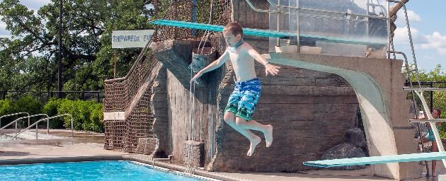 Little Boy Jumps from Diving Board