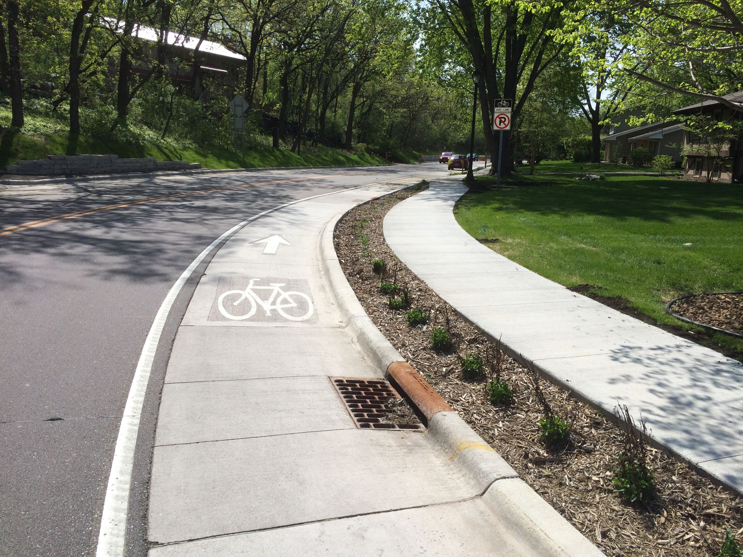 roadway with bike lanes and concrete sidewalk