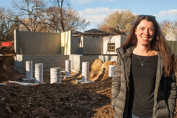 Kelsey Arneson stands outside her Countryside home that's being rebuilt