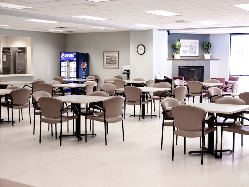 Tables and chairs in the Fireside Room at the Edina Senior Center